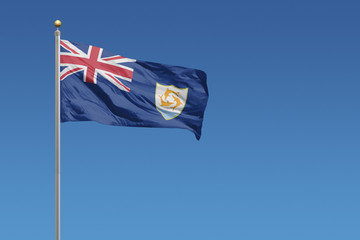 Flag of Anguilla flying on a clear blue sky