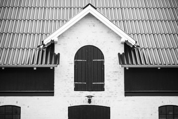 Black and white photo of a modern barn