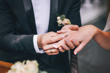Young wedding couple holding hands