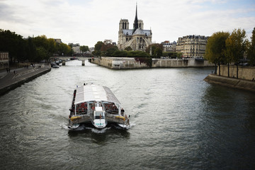 A sightseeing boat on the Seine River.