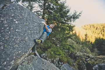 Climber bouldering near Elbow Lake in Fraser Valley, Harrison Mills, British Columbia, Canada