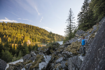 Man looking at view while bouldering near Elbow Lake in Fraser Valley, Harrison Mills, British Columbia, Canada