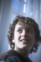 Low angle portrait of a young boy.