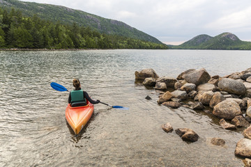Woman kayaking on Jordan Pond in Acadia National Park, Maine, USA