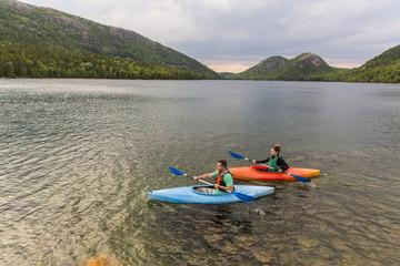 Couple kayaking on Jordan Pond in Acadia National Park, Maine, USA