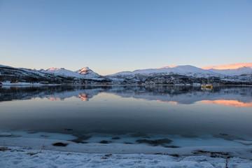 Mirror-like reflections in a Norwegian fjord near Tromsø, Norway