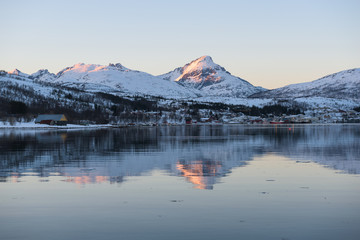 Mirror-like reflections in a Norwegian fjord near Tromsø, Norway