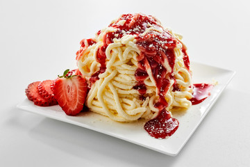 Spaghetti ice cream with strawberry topping