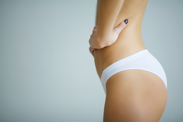 Close Up Of Woman Holding Hands In Front Of Stomach In Circular