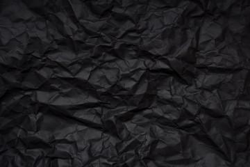 Blank crumpled black paper
