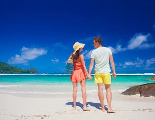 attractive couple enjoying sunny day at Baie Lazare Beach. Mahe, Seychelles