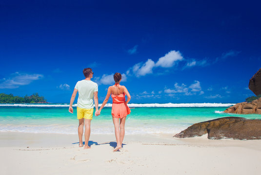 attractive couple enjoying sunny day at Baie Lazare Beach. Mahe, Seychelles