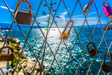Split mediterranean romantic scenery. / Scenic view at romantic padlocks on iron fence in Split city, popular travel destination on Adriatic coast, Croatia