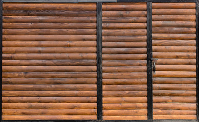 Old Wooden gate with door close up. Retro design