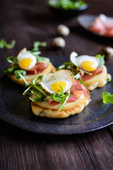 Savoury yoghurt and scallion pancakes with Black Forrest ham, smoked cheese slices, quail egg and arugula