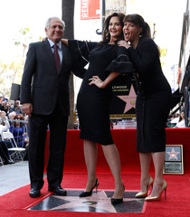 Actor Carter poses with CEO of CBS Corporation Moonves and director Jenkins after unveiling her star on the Hollywood Walk of Fame in Los Angeles