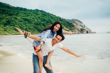 Young happy couple  making selfie at the beach