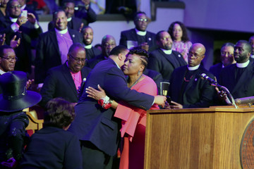 Dr. Bernice King, daughter of MLK, hugs her brother Martin Luther King lll, inside Mason Temple COGIC in Memphis