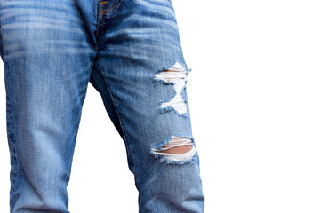 Fashion man's legs in rip jeans isolated