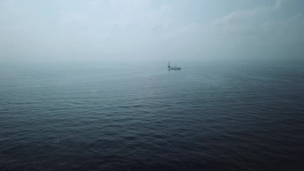 Wall Mural - Aerial view from a drone of a tender assisted drilling rig in the middle of the ocean view