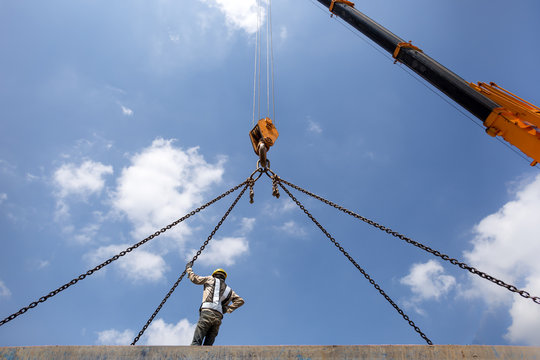 Construction worker with crane hook
