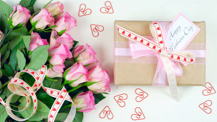 Happy Mother's Day overhead with gift and pink roses on white wood table background