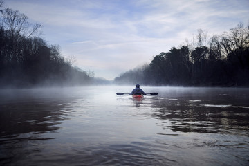 Rear view of man kayaking on Chattahoochee River