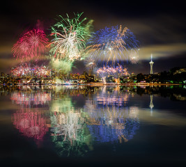 Seattle skyline and RGB fireworks with reflections