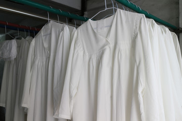 Clergy's white clothes. Dry on clothes hangers. The priests and priests wore in the church.Close up.
