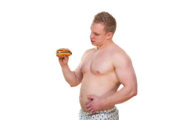 Fat man with hamburger isolated Junk meal leads to obesity. Disruption from diet concept. He is trying to go on a diet.