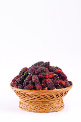 sweet mulberries in  brown basket on white background healthy mulberry fruit food isolated