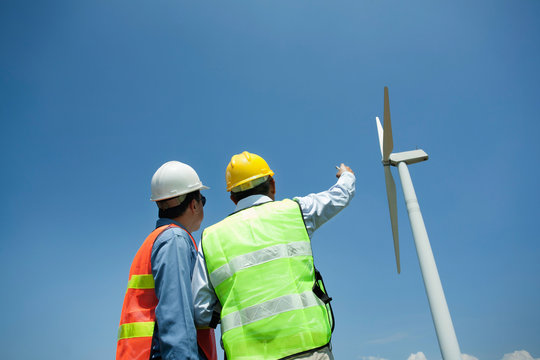 Male Engineer or technician at Work wind turbine station,wind enegy concept