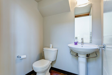 White powder room interior in apartment