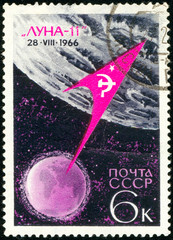 Ukraine - circa 2018: A postage stamp printed in Soviet Union show Flight of 2nd Moon Probe Luna-11and pennant mounted on the surface of the moon. Series: Space Achievements. Circa 1966.