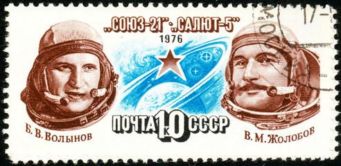 Ukraine - circa 2018: A postage stamp printed in Soviet Union show cosmonauts Volynov, Zholobov. Circa 1976