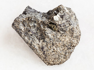 rough peridotite stone with phlogopite on white