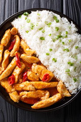 Thai food: Panang curry with rice close-up. Vertical top view from above
