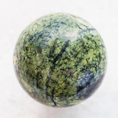 ball from Serpentine gemstone on white