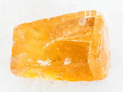raw tea Calcite stone on white marble
