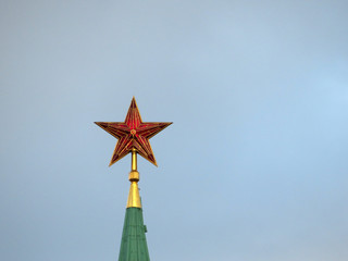Kremlin Red star against a sky. Soviet and russian symbol on top of the tower on Red Square in Moscow