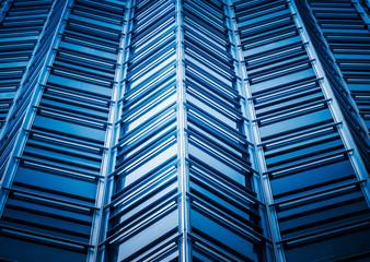 full frame of modern glass building,blue toned.