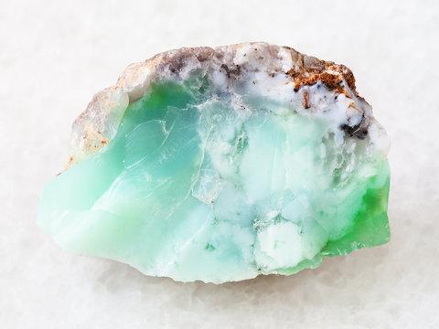 rough crystal of Chrysoprase gemstone on white