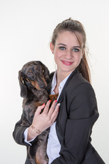 beautiful young pretty woman with a dog in her arms