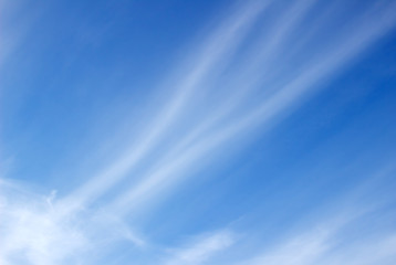Streak of an airplane flying in the clear blue sky