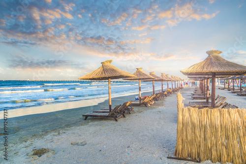 Wall mural Beach with chairs and umbrella in Mamaia Holiday Resort, black sea coast, Romania.