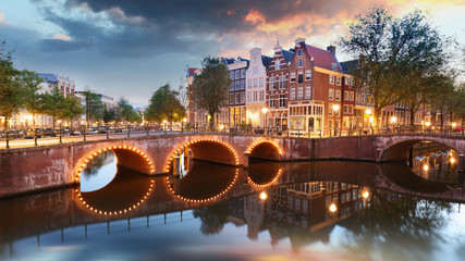Spoed Foto op Canvas Amsterdam Amsterdam at night - Holland, Netherlands.