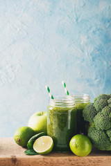 Green smoothie with ingredients, apples, lime, broccoli and spinach.