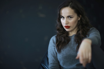 portrait of a glamorous woman / bright red lips, make-up, hairstyle, glamorous style. modern fashion concept