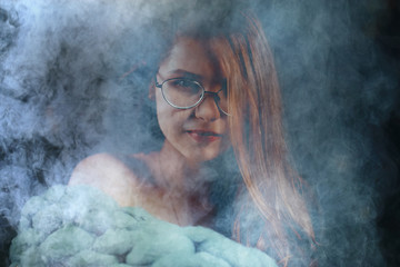 portrait of a woman in a smoke, eyes in glasses / business concept, beautiful woman, sexy business girl. Stress, smoking, relaxed.