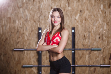 Photo of sports woman with arms crossed at waist